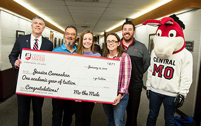 Jessica Carnnahan, Lee's Summit, receiving UCM's Free Tuition Giveaway Award, January 18, 2019.